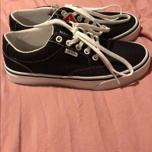 ***New with Tags*** Black Vans tennis shoes.